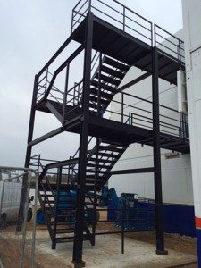 stairs and platforms being used for a multi storey portable building application